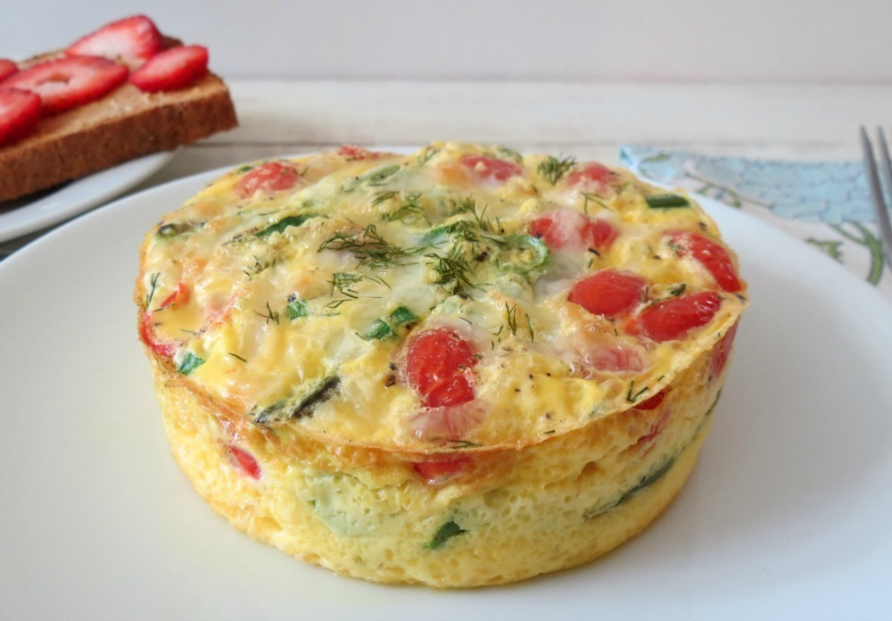 Baked Egg With Tomato And Dill Recipe — Dishmaps