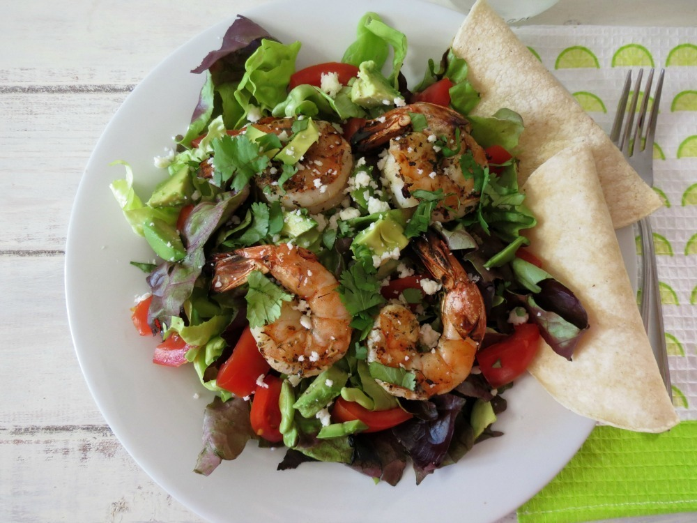 garlic and lime grilled shrimp salad topped with a cilantro lime ...