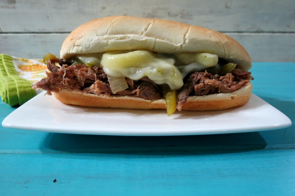 Flank steak slow cooked with onions and peppers, topped with provolone ...