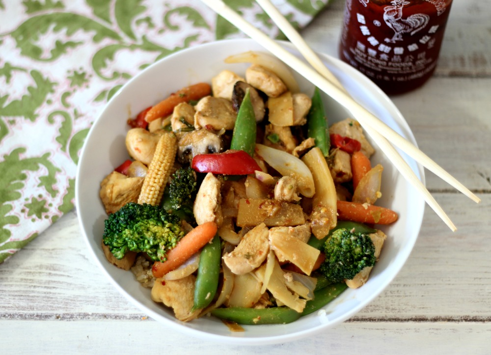 healthy stir fry made with vegetables, chicken and topped with a spicy ...